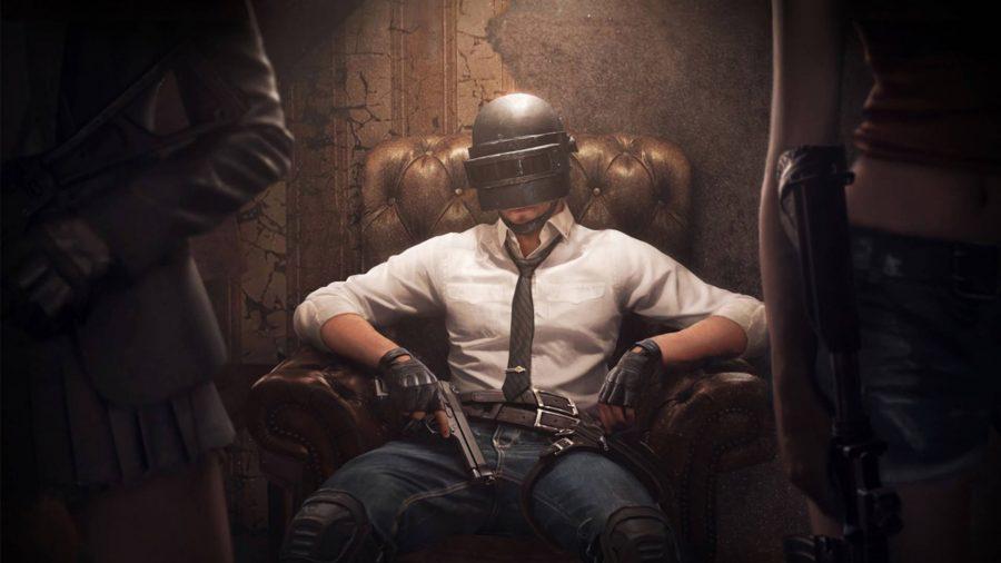 A man sitting in a luxurious chair with a gun