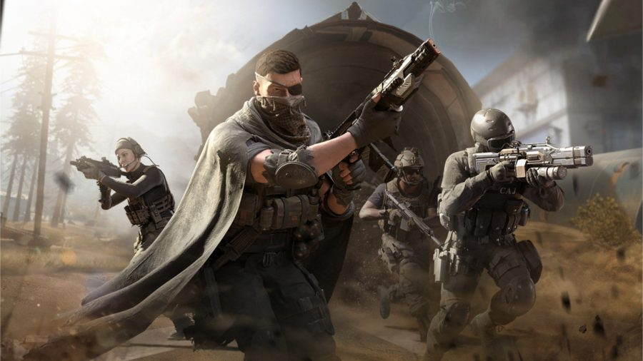 Four soldiers aiming downsights with their guns
