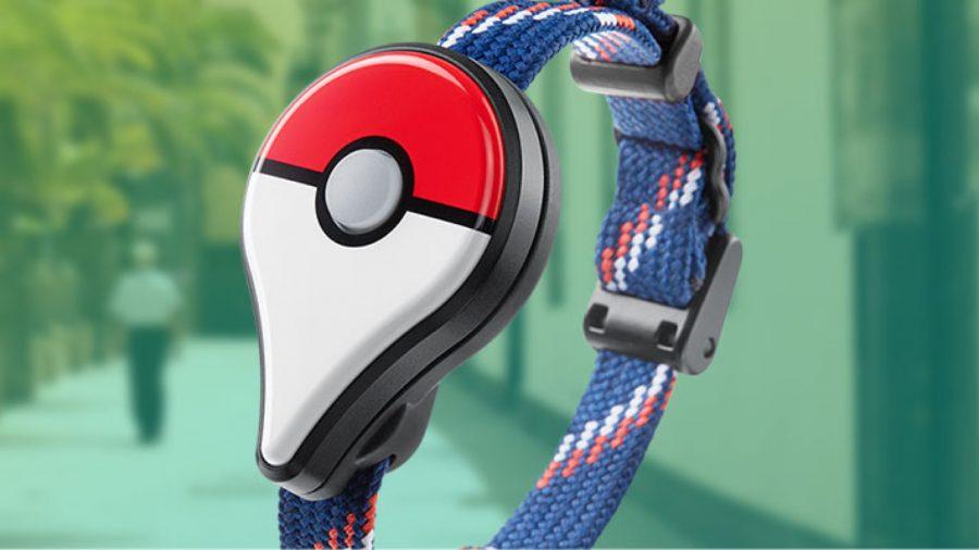 The Pokémon Go Plus device against a green background