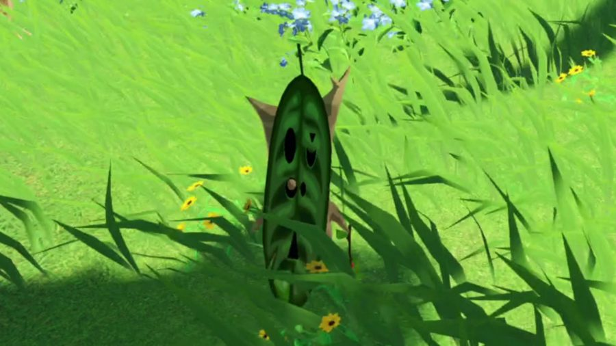 One of the Koroks - little plant people with masks - in Age of Calamity. This one has a long green mask with black spots.