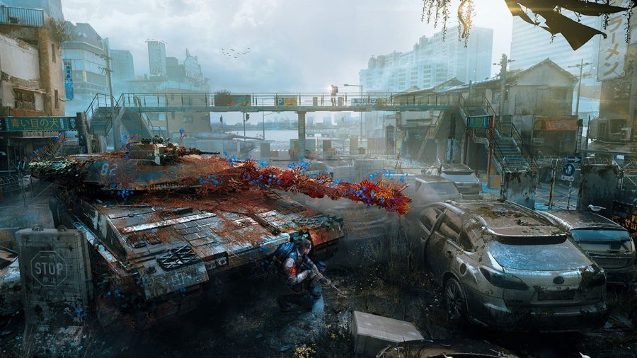 A soldier crouching behind a tank in a post apocalyptic street