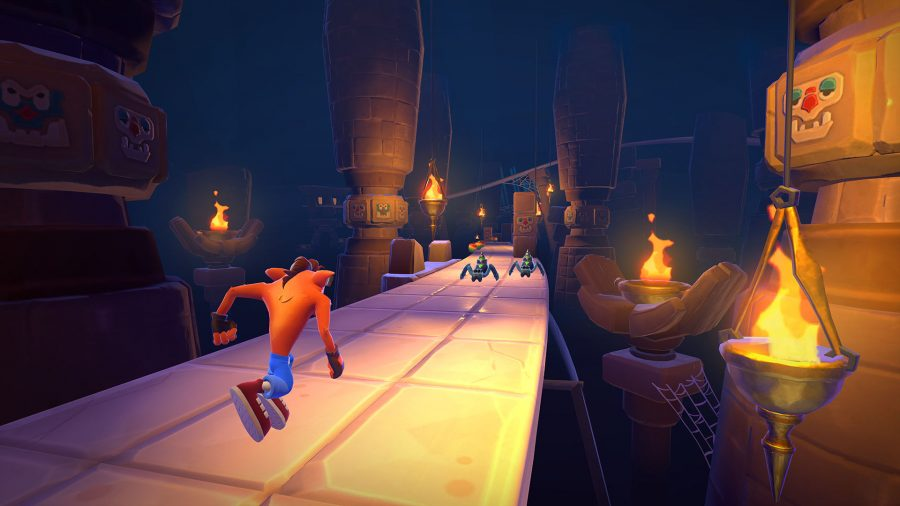 Crash running through a dark temple in Crash Bandicoot: On the Run