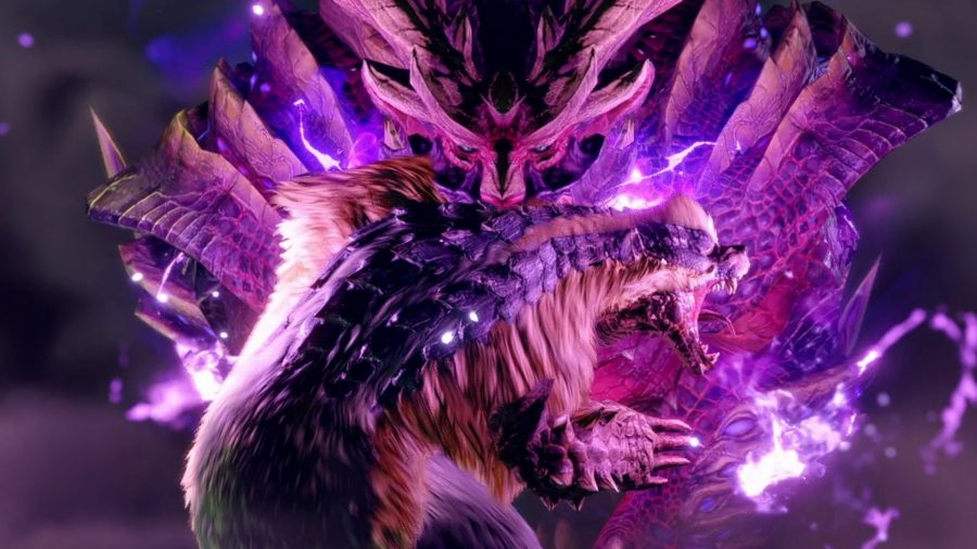 A Magnamalo from Monster Hunter Rise is pictured, glowing purple and looking menacing, it carries a smaller monster in it's mouth