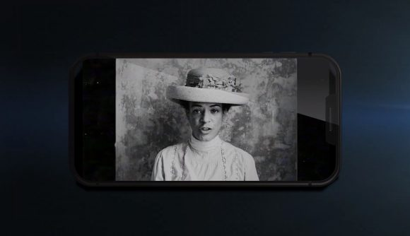 A woman in black and white wearing a hat