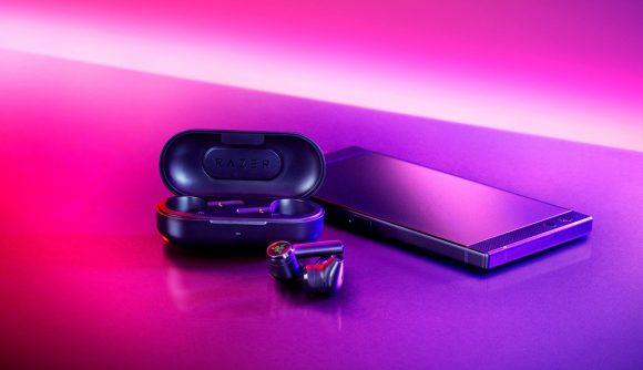 Razer Hammerhead earbuds bathed in purple light