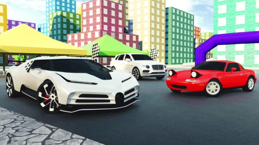 Three sports cars parked in front of buildings