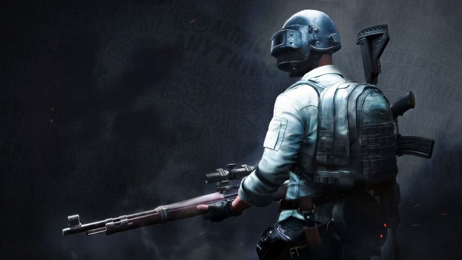 A soldier in PUBG wielding a sniper rifle against a dark background