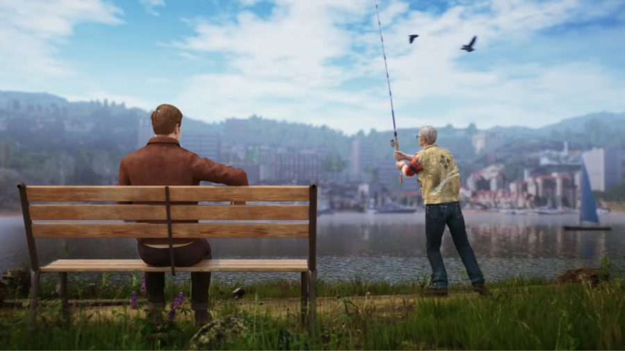 a man sat on a bench watching someone fish