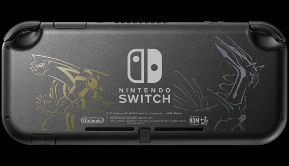 The back of a Nintendo Switch Lite is shown, with a black colour all over and a gold and silver metallic detail showing the legendary Pokémon Dialga and Palkia