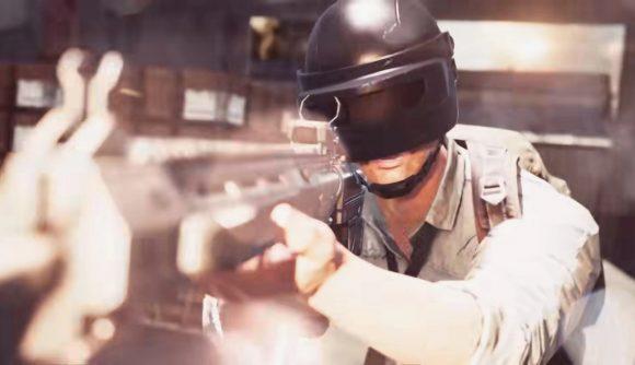 A man wearing a visor holding a large gun
