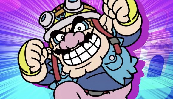 Wario is pictured enthusiastically punching the air, wearing his WarioWare biker outfit