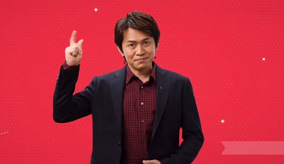 Yoshiaki Koizumi appears, holding his fingers together and snapping them to imitate the Nintendo Switch snap