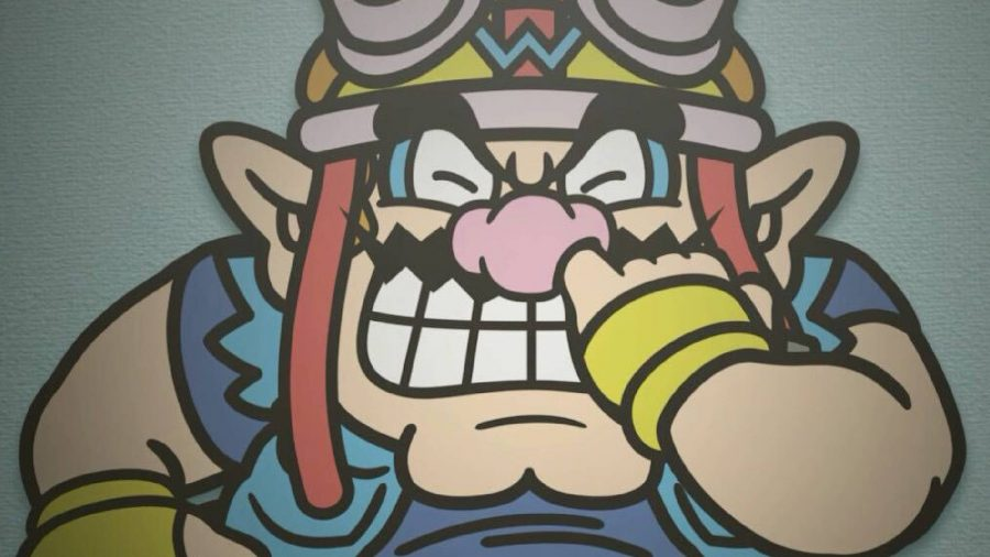 Wario painfully stabs a finger up his own nose