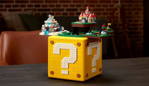 A large LEGO set shows a Question Block from Super Mario, opening up to reveal a diorama of Super Mario 64 levels