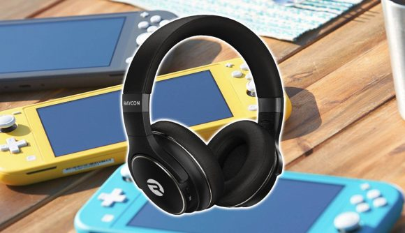 A pair of wireless over-ear headphones are shown in front of a collection of Nintendo Switch Lite consoles