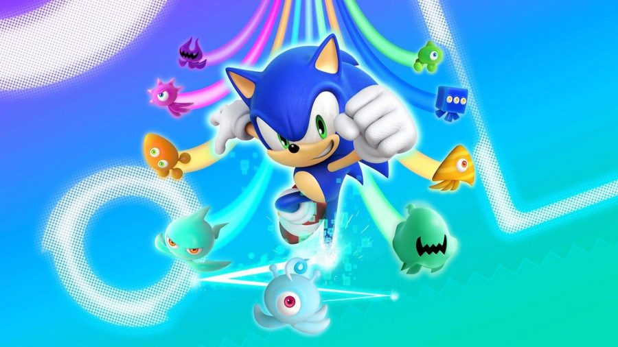Sonic jumps forward with his fist raised triumphantly, while the alien creatures Wisps zoom behind him