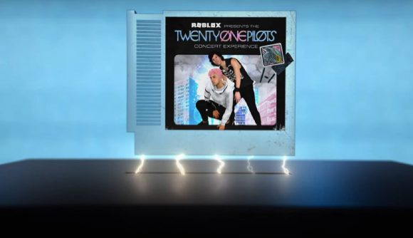 A game cartridge featuring the band Twenty One Pilots is being lowered into a black console while lightning sparks underneath