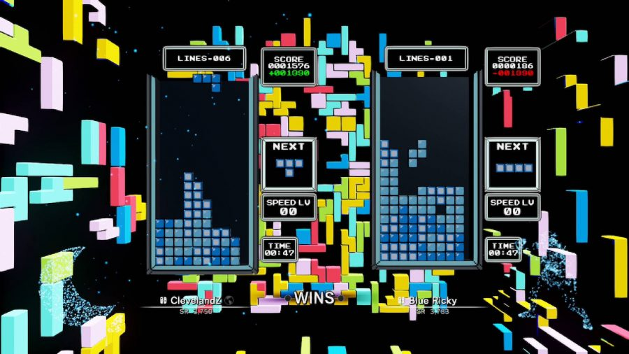 Two players play competitively in a game of tetris, while the background is lit up with neon tetris blocks